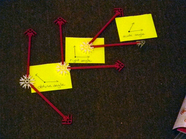 obtuse, right, and acute angles, modeled with knex aligned according to size.