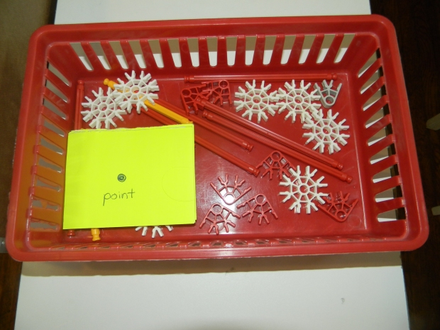 structured geometry task in a red plastic tray